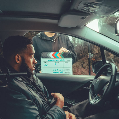 Jamaal filming for BBC short film sat in car